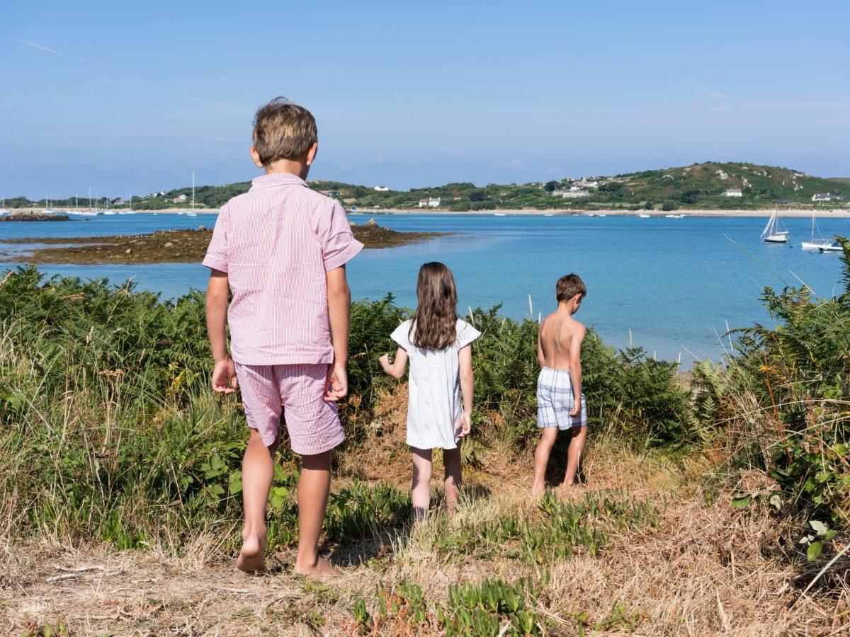 Children walking down hill on Tresco